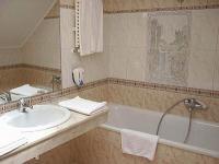 Modern fürdőszoba a budapesti Unio Hotelben a Dob utcában - Hotel Unio Budapest